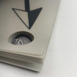 livre d'artiste de Julien Blaine, réalisé en papier calque, imprimé et perforé sur toute l'épaisseur du bloc